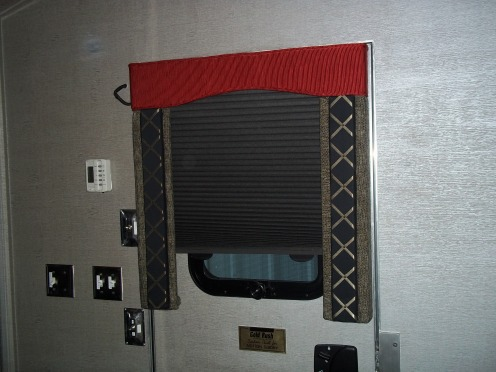 Custom window valances and shade treatments in this stacker trailer. #Prevost #TradewindsCoach