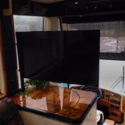 Check out this 'flag pole' TV bracket installation. Great alternative for owners who aren't thrilled with flip-down TVs. It's also great for passengers who want to watch TV during travel!